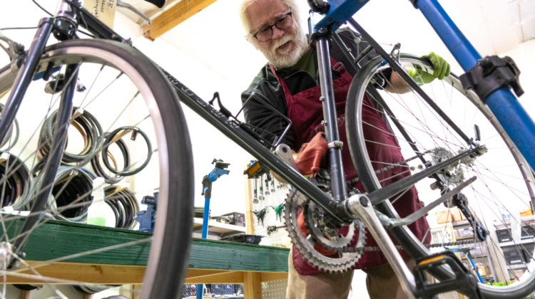 A Silicon Valley Bicycle Exchange volutneer working on a perfect gravel bike candidate, for someone in need of a bike.