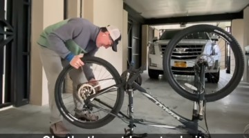 Stephen Colbert fixes a flat tire during the coronavirus shelter-in-place order.