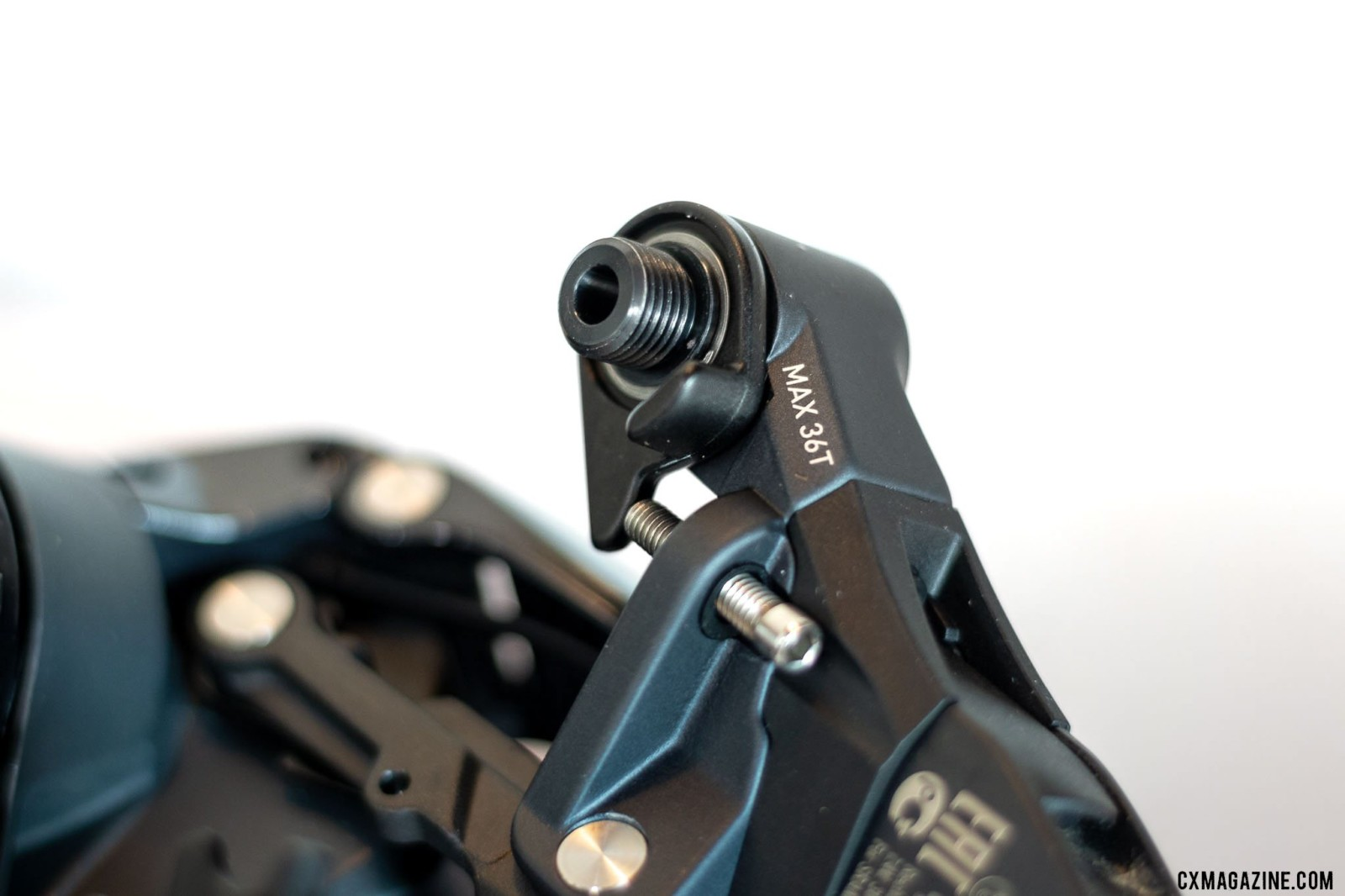 The new wide-range SRAM Force AXS eTap rear derailleur looks similar to the previous design, but has label on the b-knuckle that tells you if it'll work with the new 10-36t cassette. © Cyclocross Magazine